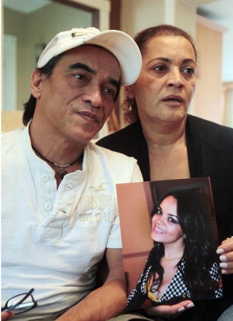 Juan Luis Torres and Coralia Espinosa hold a photo of their daughter, Suyima Torres, who died in September 2013 after a butt enhancement procedure at a Miami clinic. Roberto Koltun El Nuevo Herald