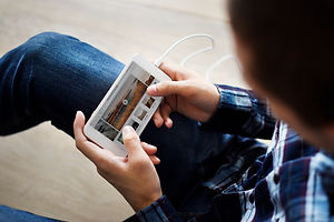 man-using-a-smartphone-and-music-playlis
