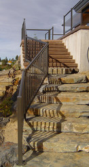 Bronze/Brown Round Top Picket railing with Landscape