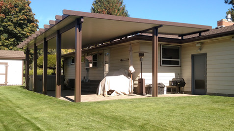 Newport patio cover, brown frame, white pans, roofmount