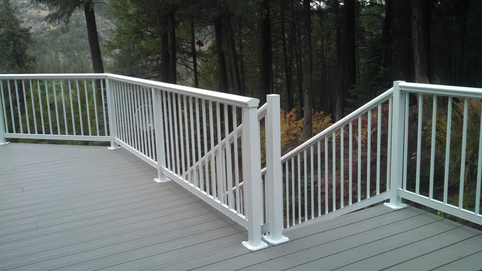 Elliptical Picket Railing Around Deck, Round Top Down Stairs