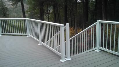 Elliptical Picket railing around deck, round top down stairs