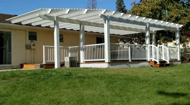 Huge, beautifully designed Pergola with picket railing all around.