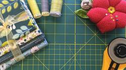 Mat Fabric Cutter Pincushion Thread.jpg