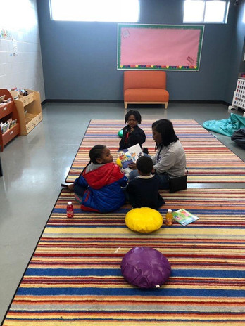 Mother reading with her children