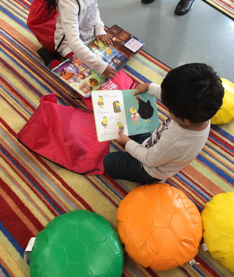 READ kids enjoying their take home books