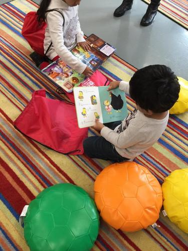 2_15 READ  kids enjoying books to take h