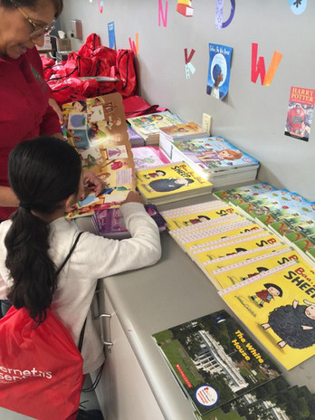 Child selecting books to take home