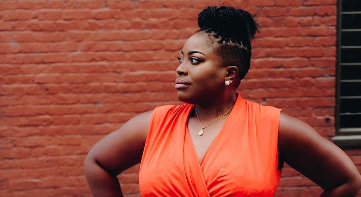 woman-wearing-orange-sleeveless-top-9360