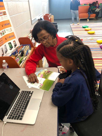 Volunteer helping with reading