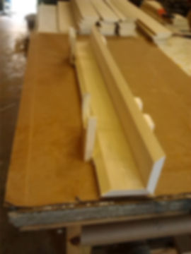 Stands holding boards in place for gluing