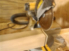 Cutting the end of the newel on miter saw