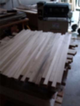 Balusters sanded on drum sander