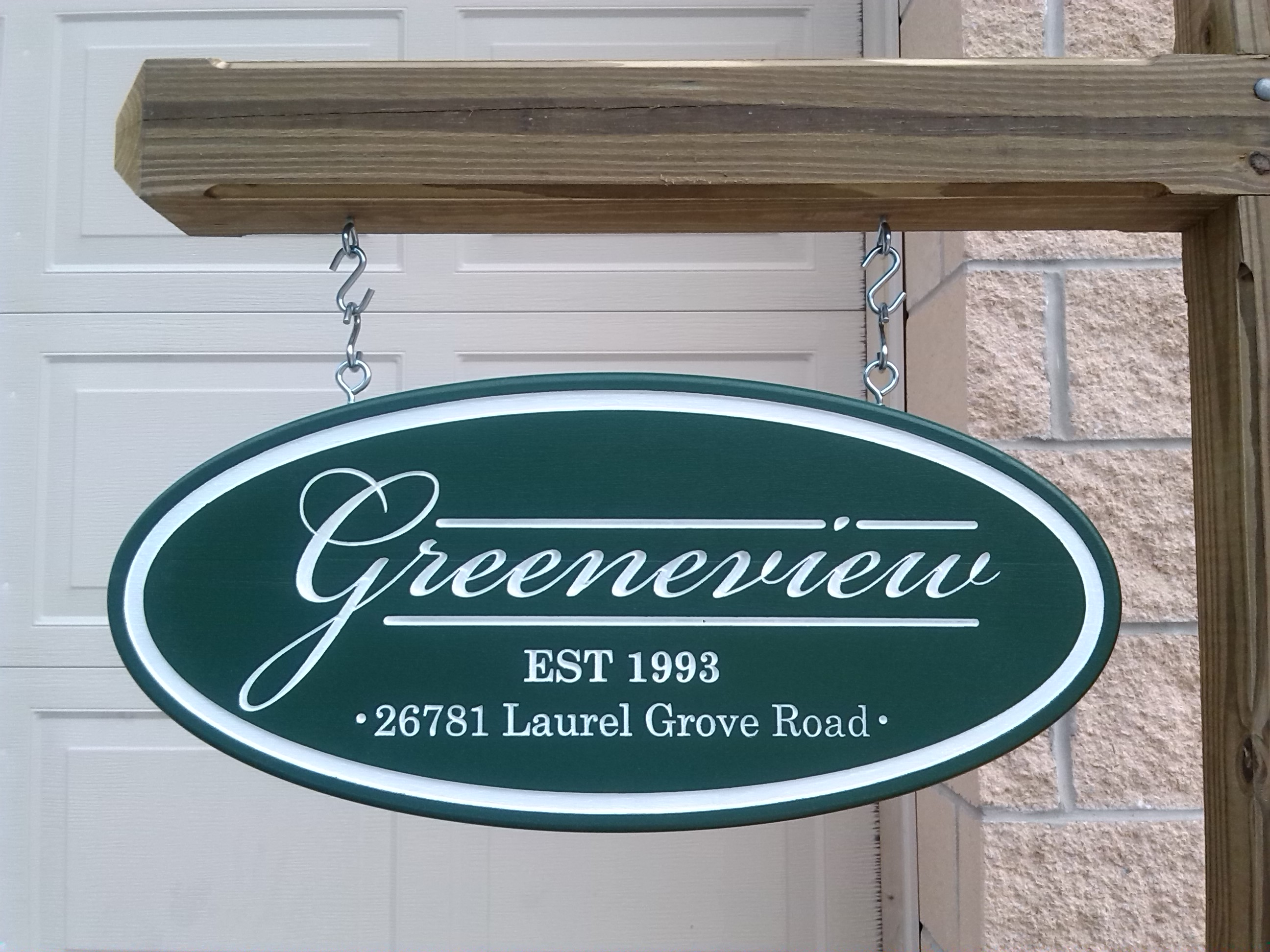 Exterior dimensional carved sign