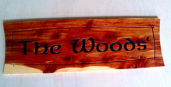 Custom carved wood sign with name.