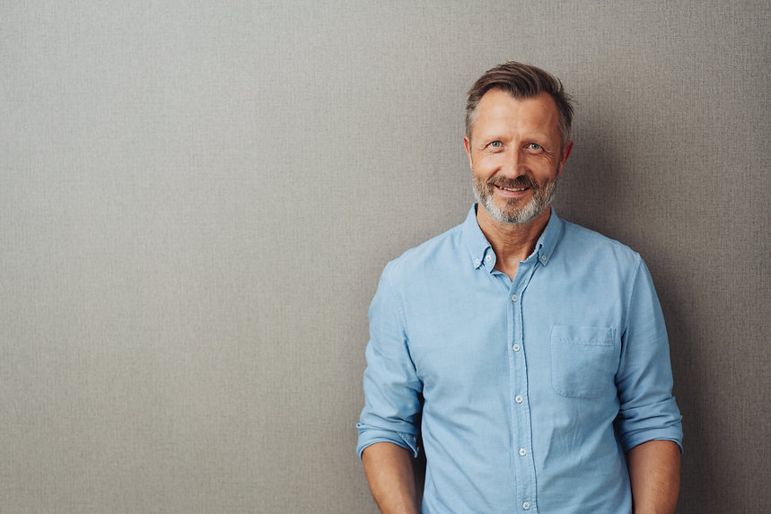 Relaxed attractive smiling middle-aged m