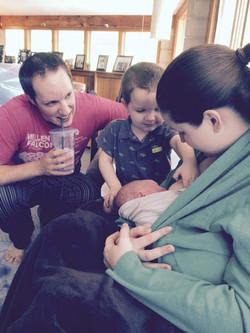 family welcomes newborn.jpg