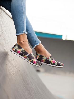 Girls feet wearing canvas shoes