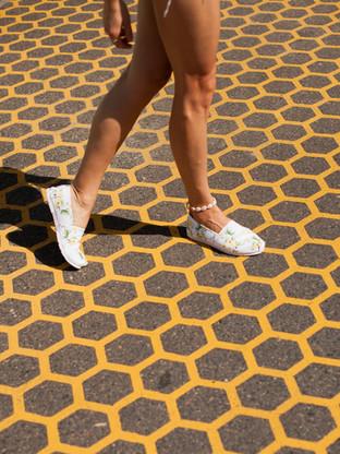 Womans legs crossing a road