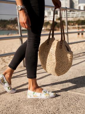 Womans legs in jeans at Bondi Beach