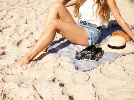 Girl sitting on Bondi Beach