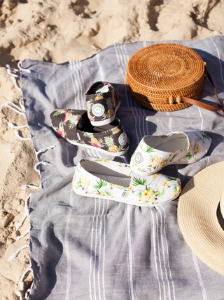 Canvas shoes on towel on Bondi Beach