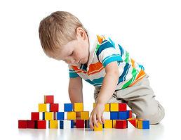 lone child building stuff at Triumphant Kids Nursery