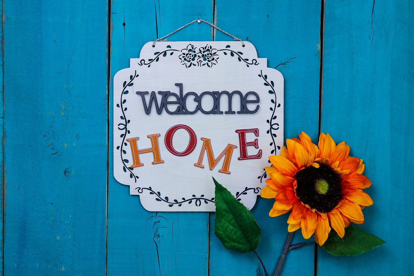 Welcome HOME sign with orange, yellow an