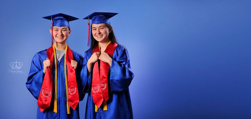 Two_high_school_senior_girls_graduating_