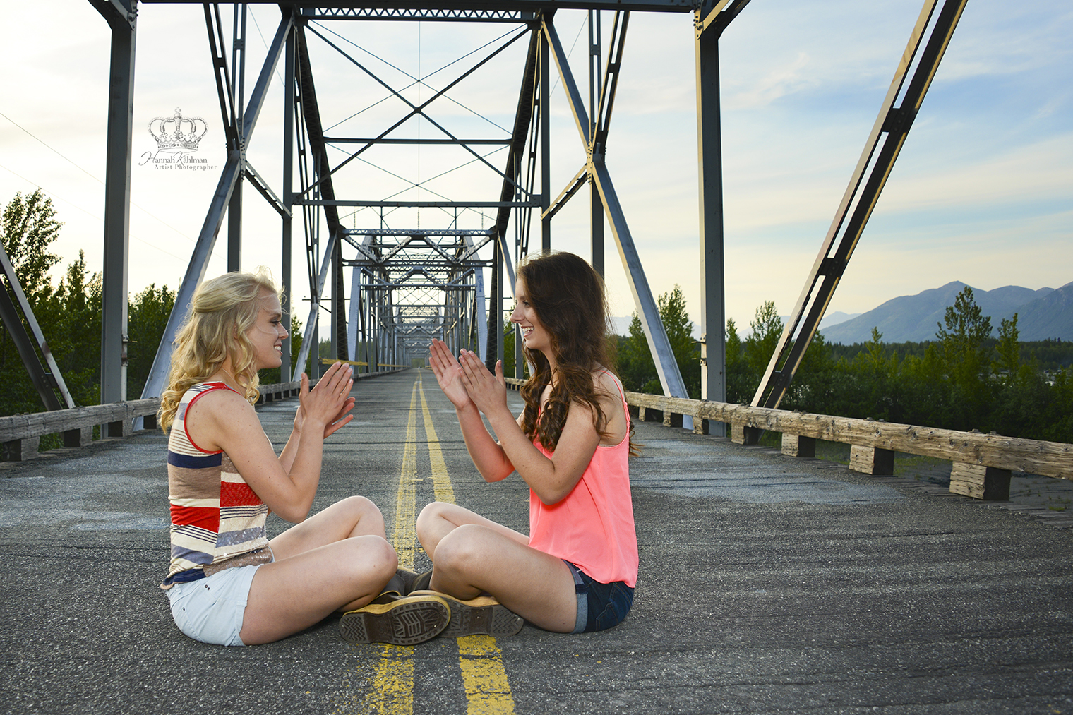 Two_High_school_senior_girls_on_bridge_i