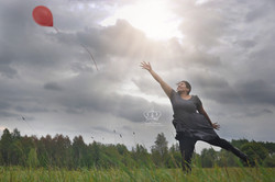 woman_jumping_in_field_outdoors_after_ba