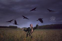 Fine_Art_self_portrait_with_birds_ravens_in_Minnesota_field_by_Anchorage_Alaska_conceptual_photograp