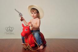 Cowboy_boy_on_horse_in_studio_cute_Anchorage_Alaska_family_photographer_Eagle_River_AK_family__Hanna