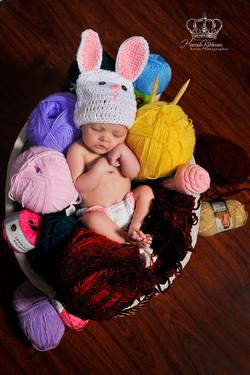 Newborn_sleeping_basket_yarn_newborn_photographer_in_studio_Anchorage_Alaska_Eagle_River_Alaska_port