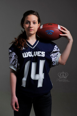 Girl_football_player_with_football_in_st
