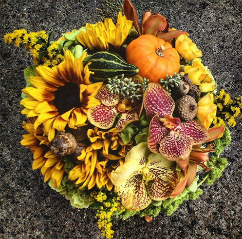 Yellow Orange Centerpiece With Exotic Orchids And Acorns