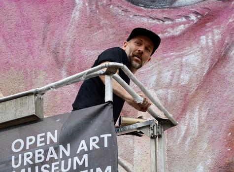 LEST WE FORGET Mural von AKUT in Mannheim F 6, 5