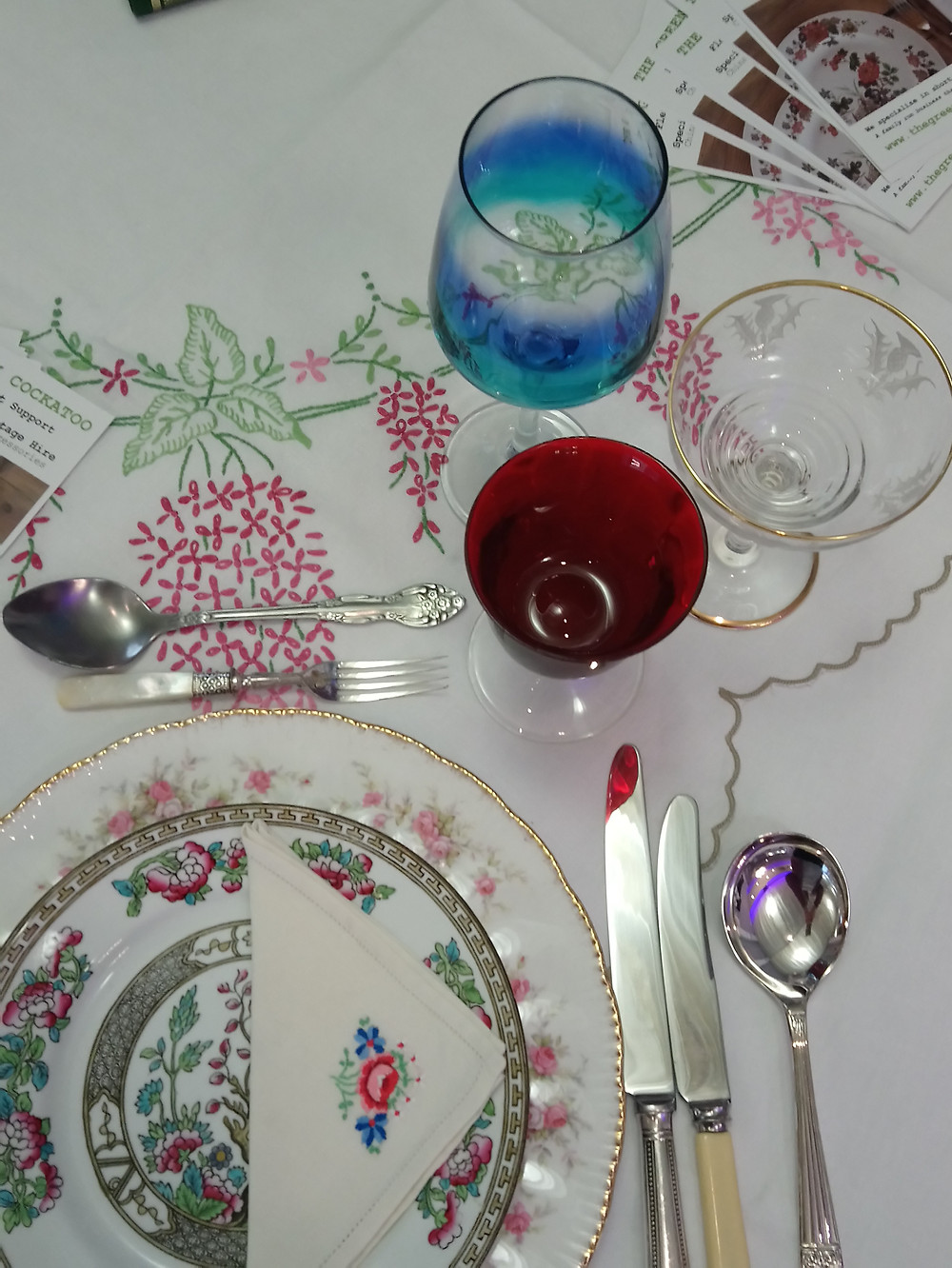 Mismatched china, cutlery and glass