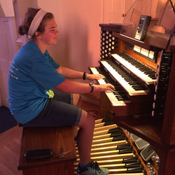 The organist's daughter helps tune