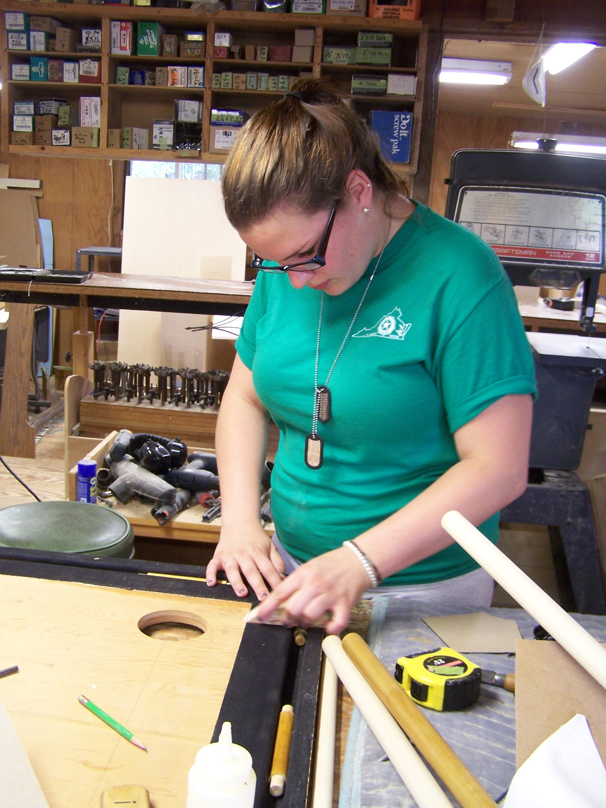 Mary Michael working on a bellows