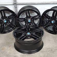 BMW 650i wheels repaired and refinished in gloss black