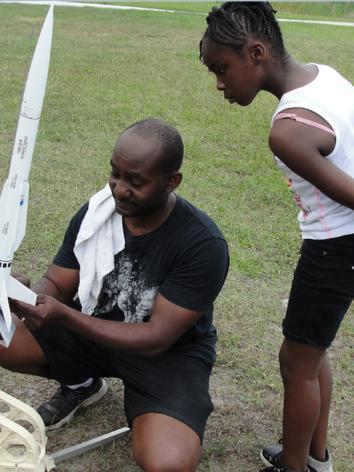 Volunteer working on student's model rocket