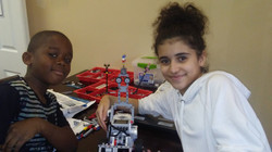 Students assembling Lego vehicles