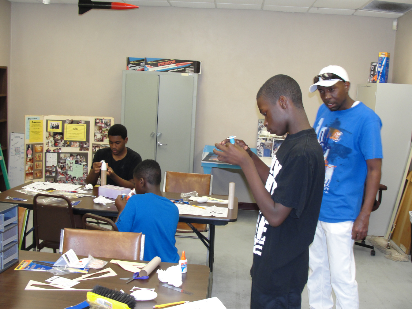 Students assembling model rockets
