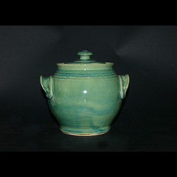 lidded blue green canister