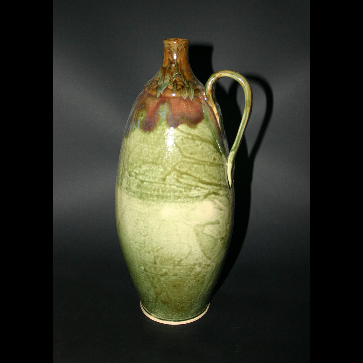 tall handled jug greenredbrown