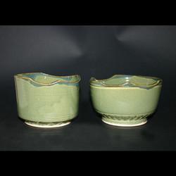 2 green odd bowls
