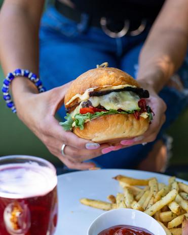 burger in hands 1.jpeg