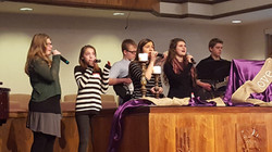 Youth singing and playing