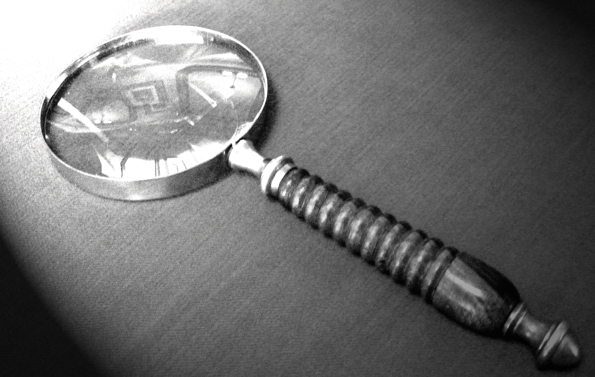 Playing Dead Murder mystery magnifying glass close up.jpg